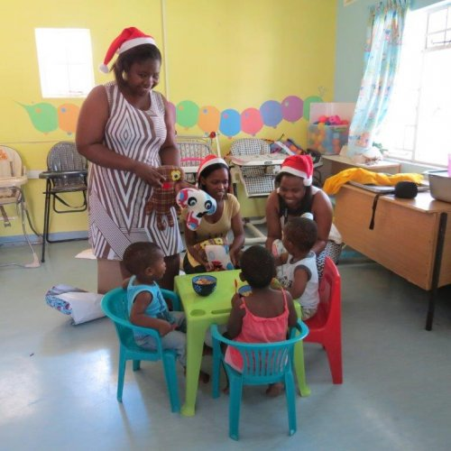 MIET AFRICAns distributing gifts to the toddlers' group