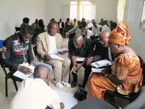 Community members from DRC engaging in community dialogues.